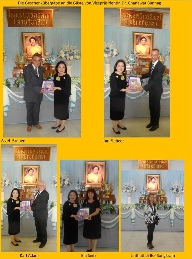 Jinthathai Bo' Songkram steht vor dem wunderschön geschmückten Foto Ihrer Majestät der Königin.