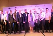 Handelskammer Präsident Markus Lorenzini ((6. von links) und Handelskammer Direktor Dr. Roland Wein (ganz links) mit Ehrengästen und Sponsoren beim Erinnerungsfoto.